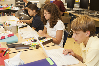 Elementary students use laptops in their lessons.