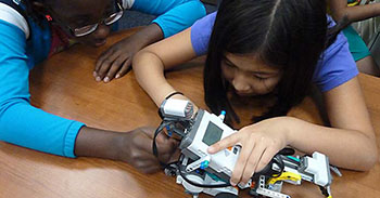 Two New Arc Academy students program a LEGO robot