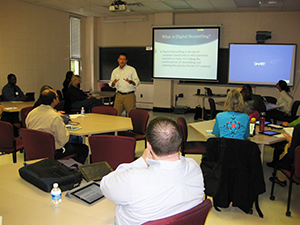 James Davis talks with conference attendees about digital storytelling